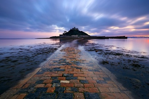 The tide begins its return, water lapping at the edge of the causeway at St Michael's Mount